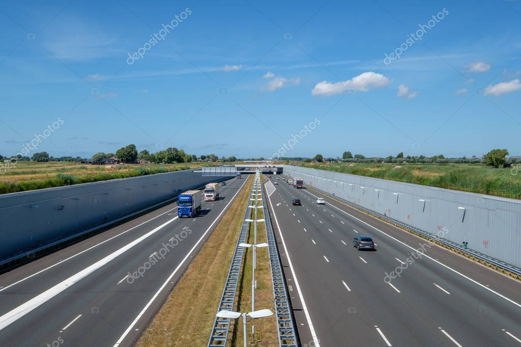 SCHIEDAM, NETHERLANDS - JUL 31, 2018 :  Highway A4, Delft-Schiedam, Netherlands. This modern highway is built in a deepened location to save the Midden-Delfland nature reserve.