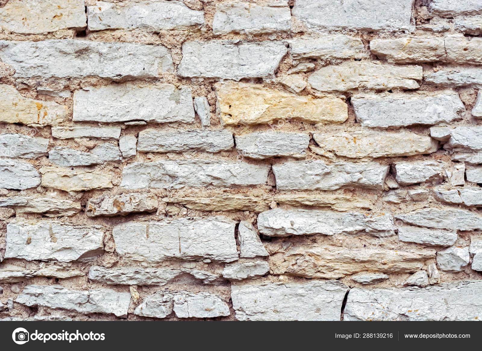 Muro Fatto In Pietra frammento di un muro di pietra. — foto stock © dotsent