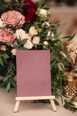 Table number and flower composition, copy space