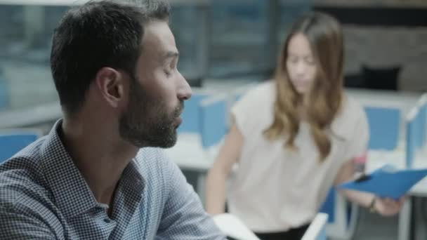 Young Business Man Talking At Work In Co-working Office