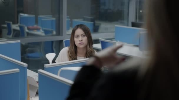 Female Boss Meeting And Talking To Young Employees In Office