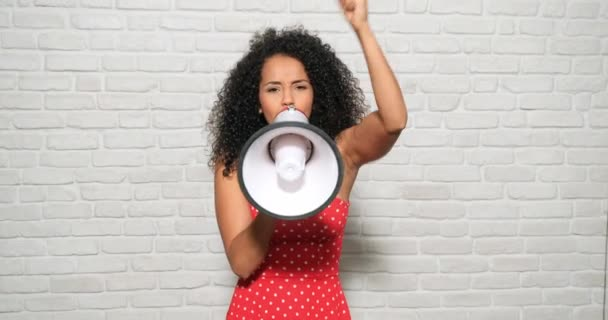 Young people, feelings and emotions. Portrait of angry african american woman shouting with megaphone for protest. Black girl showing rage, anger and rebellion for human rights, strike, pride