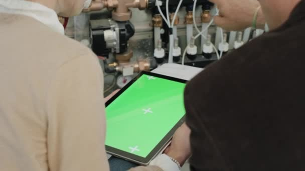 Green Screen On Ipad Tablet Computer With Businessman and Businesswoman