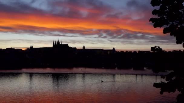 View of Prague Castle, tourist landmark on the Vltava (Moldau) river in Prague, Czech Republic, Europe. Beautiful city landscape with monuments and old building at dusk
