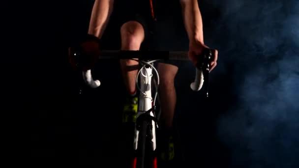 professional triathlete cycling road bike, Pedaling, sport concept, studio black