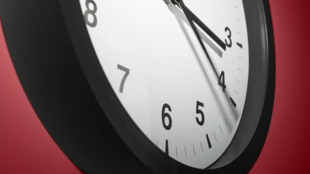 Clock Face in Time Lapse on Burgundy Cherry Red Wall in Office