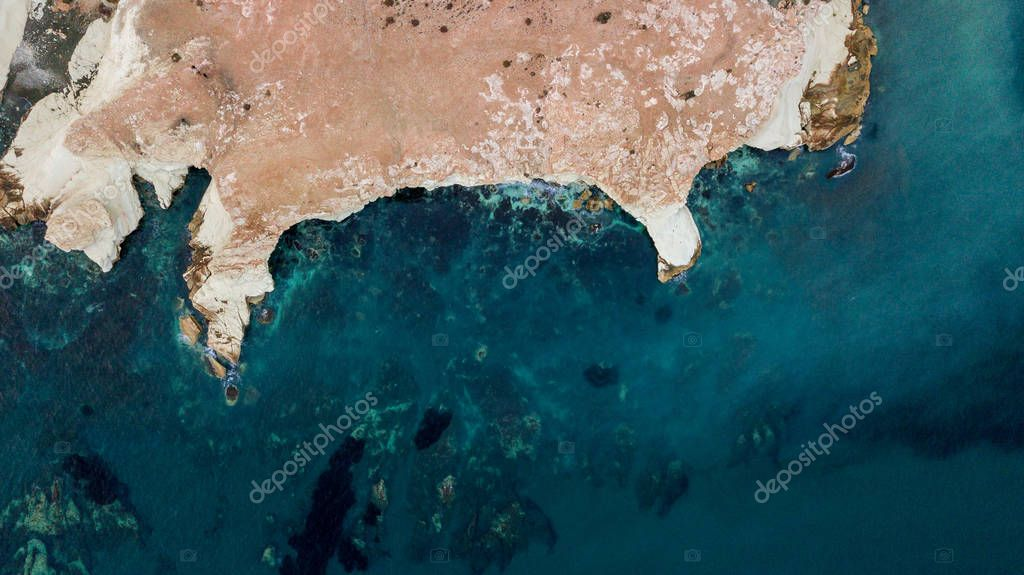 top view of rocky coast with blue water, Cyprus