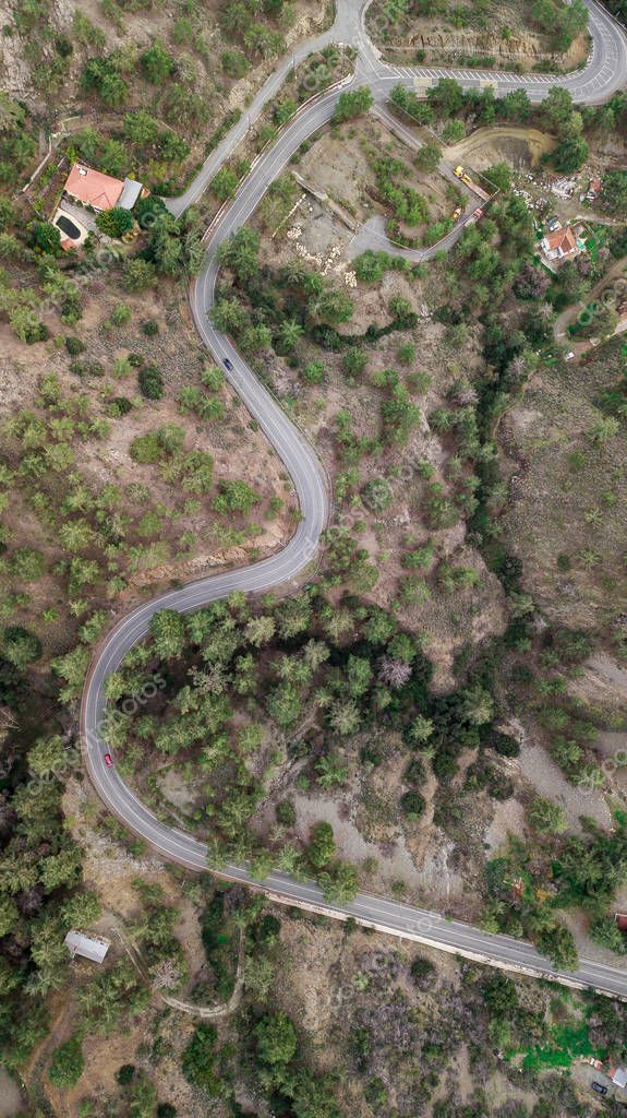 aerial view of curvy hill road surrounded with trees, Cyprus
