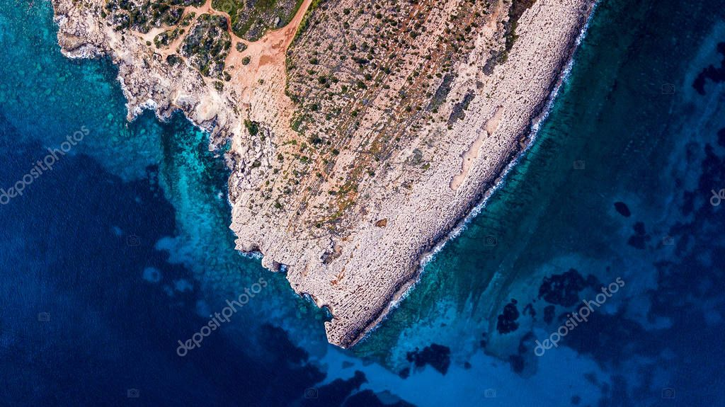 top view of dramatic rocky coast with blue sea, Cyprus