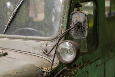 Old Soviet car. Halogen light and rear view mirror.