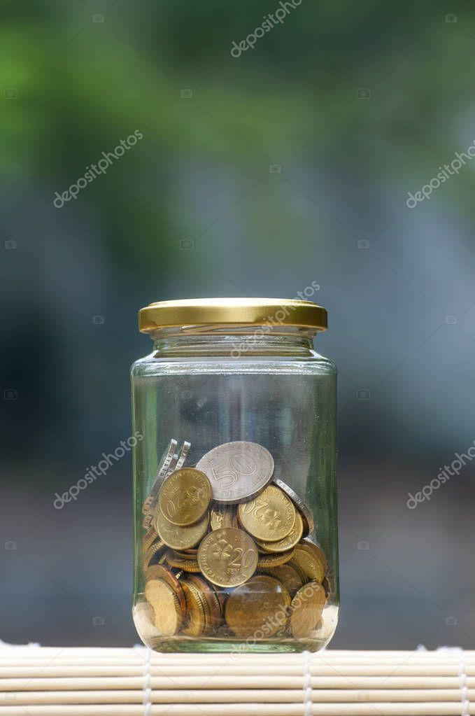 Coins in bottle  - financial concept
