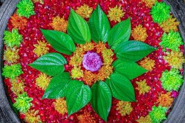 Decorative colorful flower on earthenware pot for floral bath