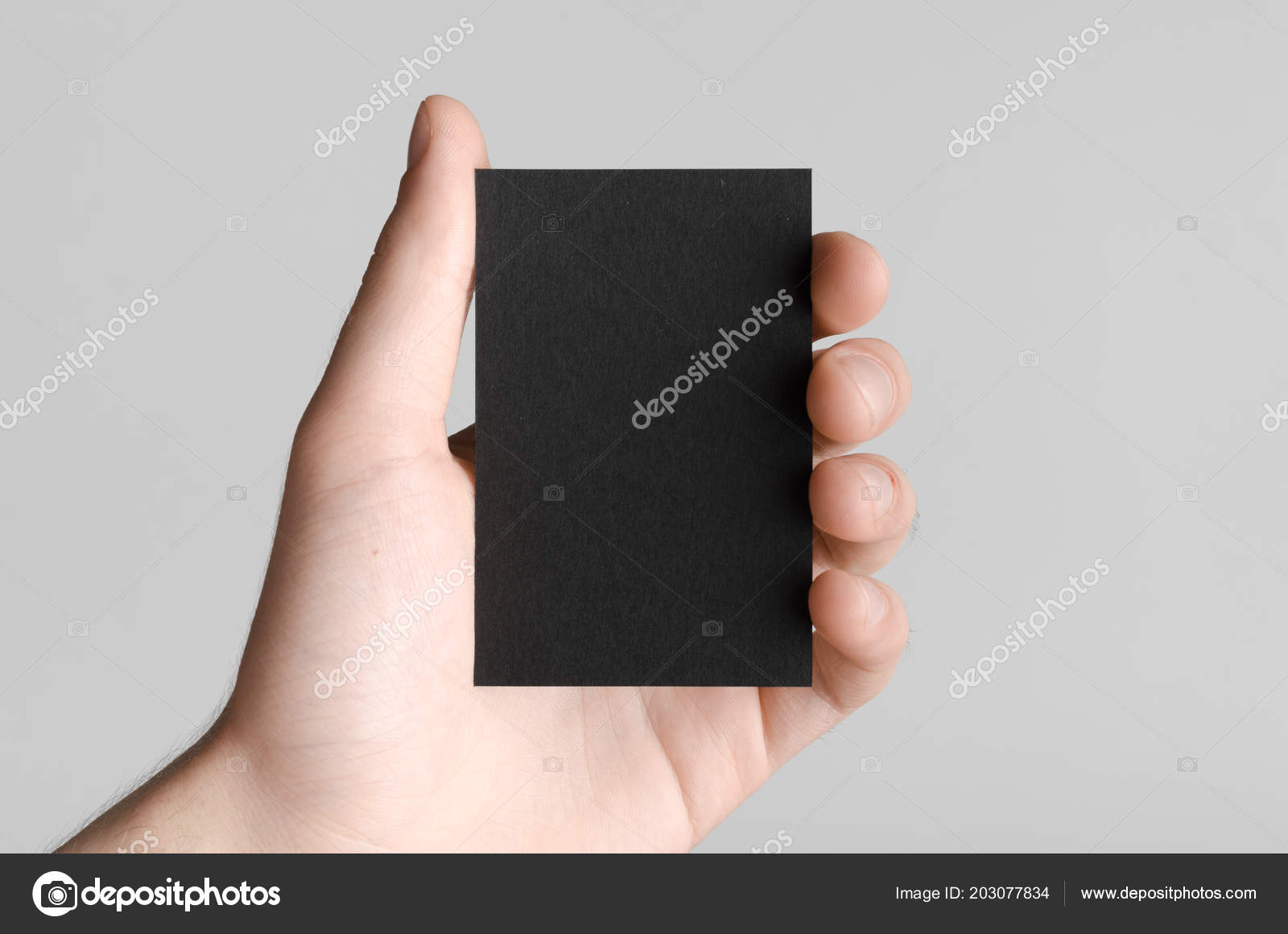 Black business card mock 85x55mm male hands holding blank card black business card mock 85x55mm male hands holding blank card fotografia de stock reheart Choice Image