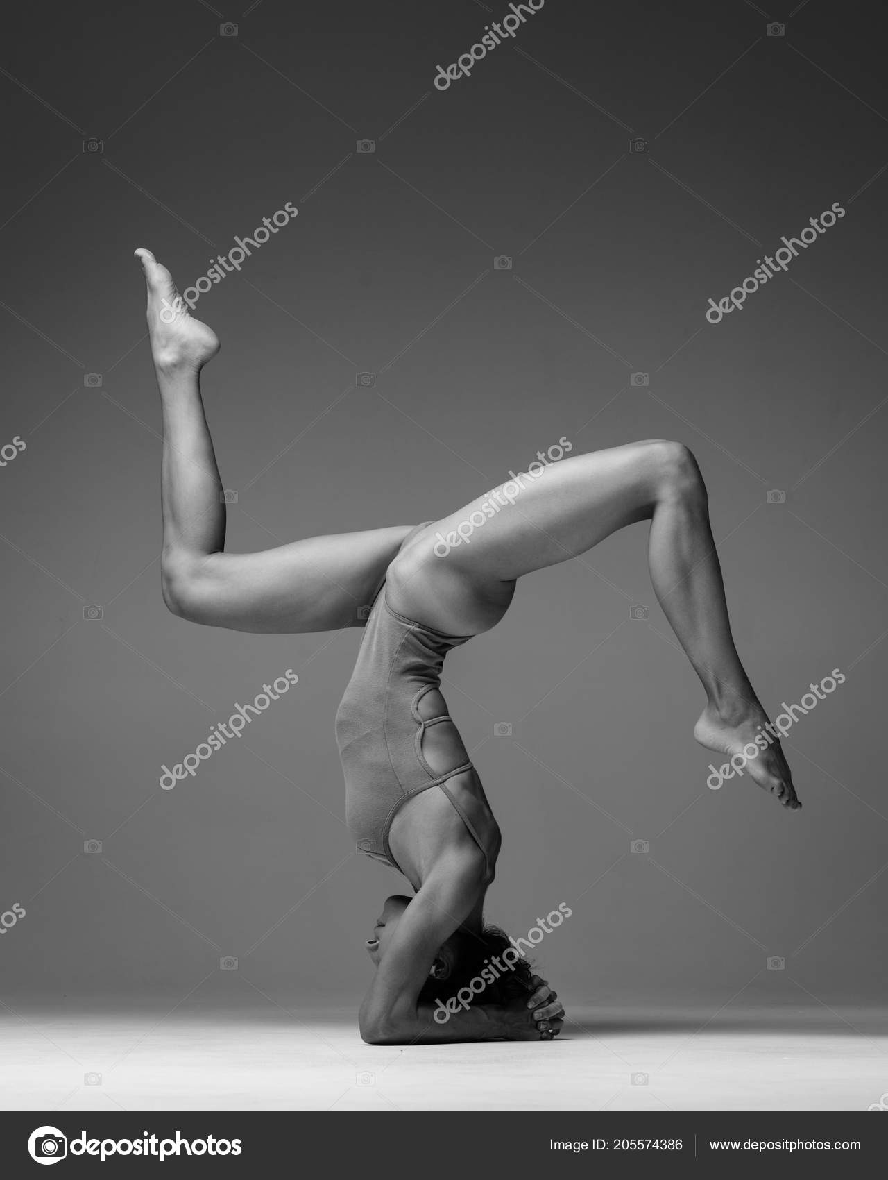 Young Beautiful Yoga Woman Is Posing In Studio Black And White Stock Photo C Ayakovlev Com 205574386