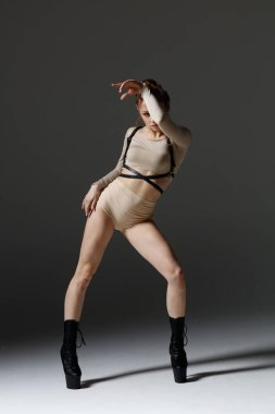 Elegant female dancing striptease dance