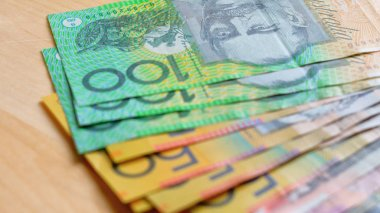 Australian currency with fives, tens, twenties, fifties and one hundred notes.