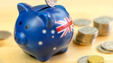 Australian piggy bank and coins savings concept, closeup.
