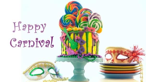 Mardi Gras téma na trend candyland odkapávací dort s animovaný text pozdravu.