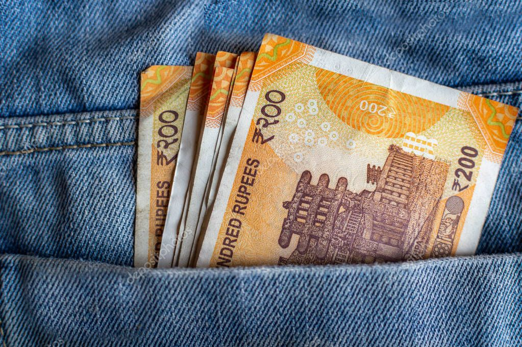 Indian currency Rs 200 notes in the pocket of a jeans