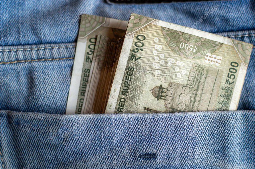 Indian currency Rs 500 notes in the pocket of a jeans