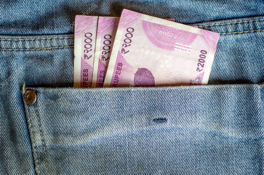 Indian currency Rs 2000 note in the pocket of a denim