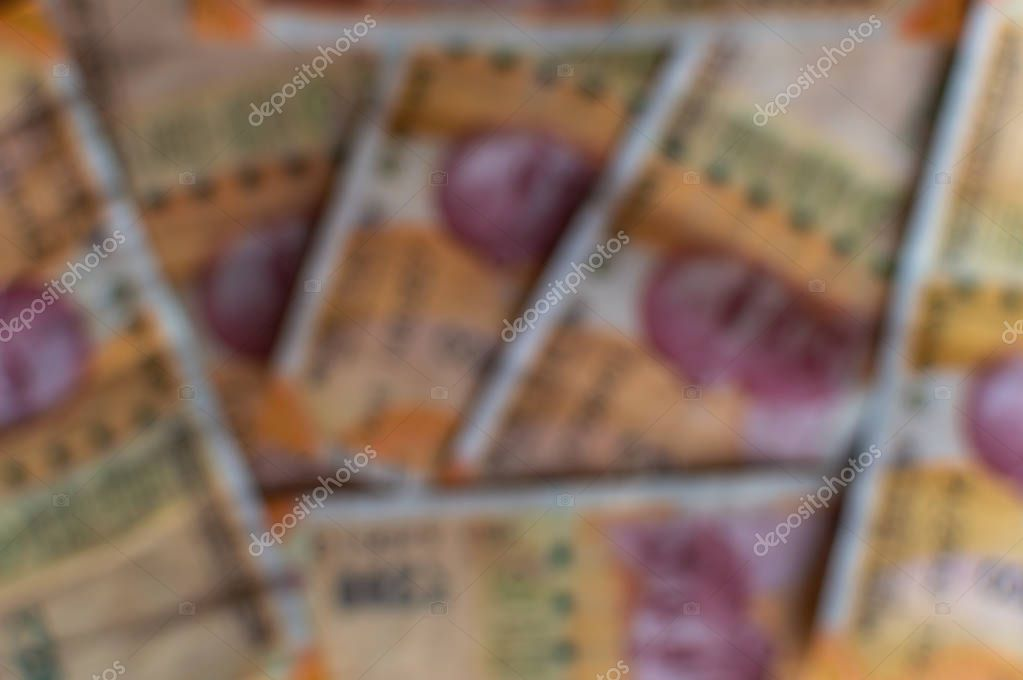 Blurred 200Rs Indian Currency notes forming a background