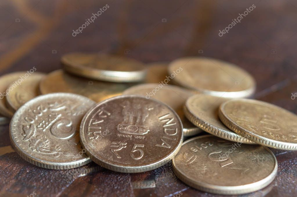 A closeup shot of Rupees Five coins of the Indian Currency made out of copper or bronze