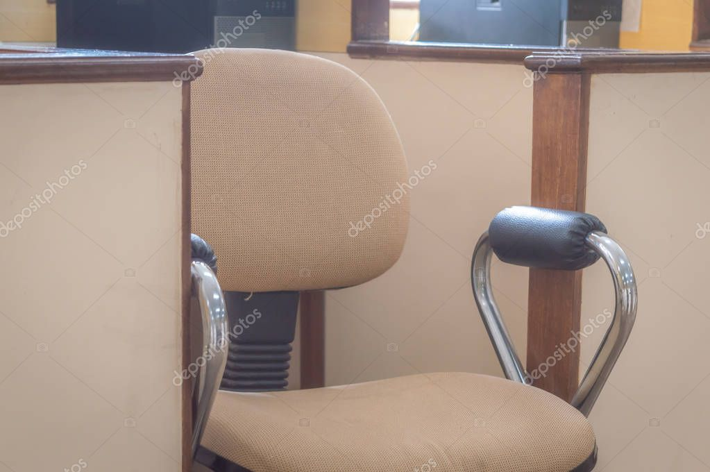 Business Executive Chair brown coloured in a small cabin space