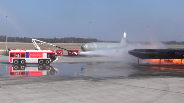 Frankfurt, Germany - October 18, 2018: Airport crash tender SIMBA and plane dummy in flames during a fire drill at FTC (Feuerwehr Training Center). The SIMBA is a large airport fire truck from the Austrian manufacturer Rosenbauer International AG.