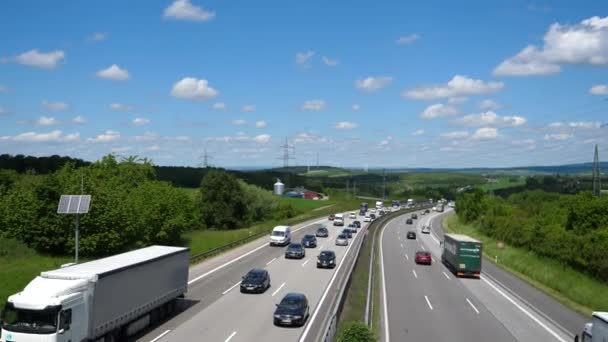 Idstein, Germany - May 29, 2019: Dense traffic and trucks on German highway  A3  A3 is a heavily frequented highway that connects the Dutch border with  Passau