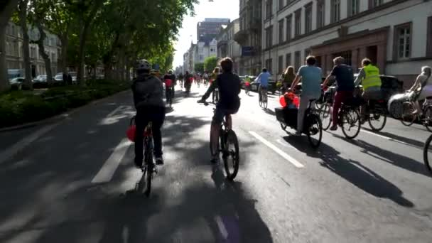 Wiesbaden, Germany - June 30, 2020: Participants of Verkehrswende demonstration demonstrate for a more bicycle-friendly transport policy while cycling through the city center of Wiesbaden. Critical mass movement.