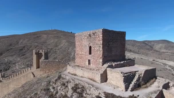 Ancient city fortress birds-eye view. Drone flies over the ancient town of Albarracin in eastern Spain. Around the mountains covered with forests.