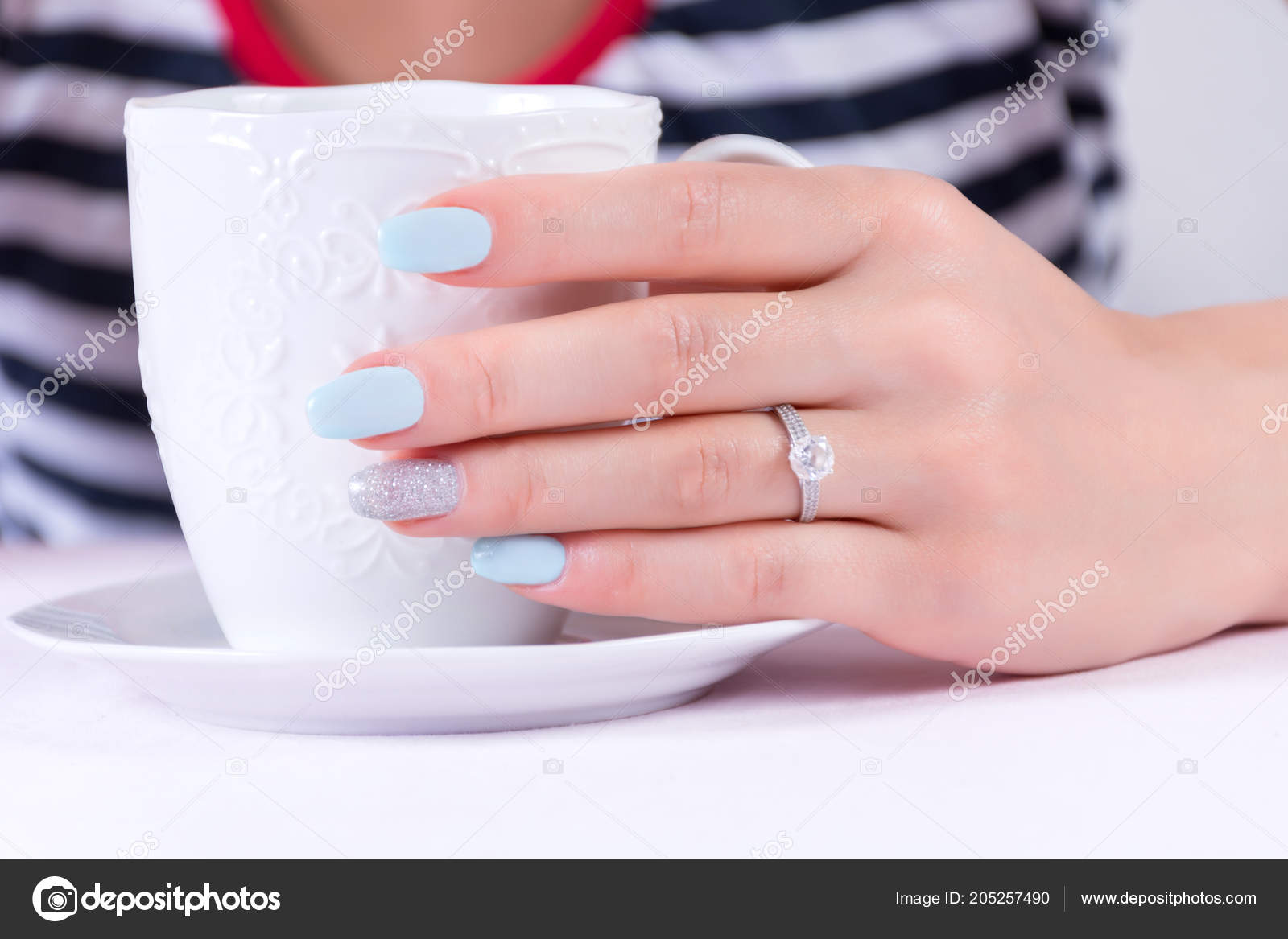 Which Hand Wedding Ring Female.Young Female Hand Diamond Wedding Ring Blue Manicure Nails Polish