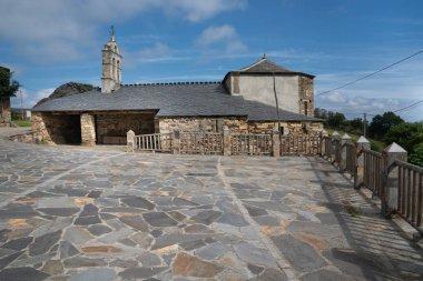 Old church Santa Maria Magdalena in sunlight with blue sky, Penafonte, Camino de Santiago close to Grandas de Salime, Asturias, Spain