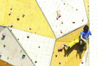 Man bouldering at an indoor climbing centre. Climber practicing rock climbing at an indoor climbing gym. stock vector