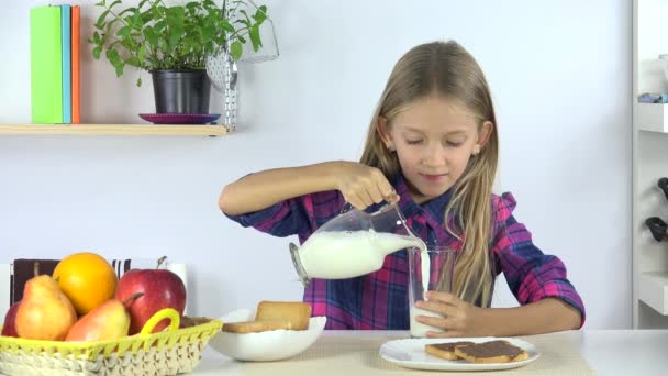 Child Drinking Milk at Breakfast, Girl Eating Bread and Chocolate in Kitchen 4K