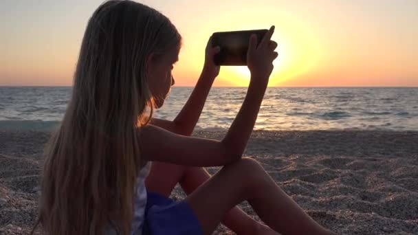 4K Girl on Beach at Sunset, Child Using Smart Phone Taking Pictures on Seashore