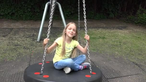 4K Happy Smiley Girl Swinging Outdoor, Child Playing at Playground Park Children