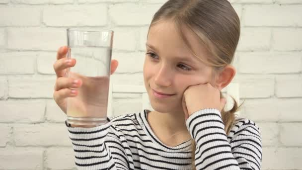 Child Drinking Water in Kitchen, Thirsty Girl Studying Glass of Fresh Water 4K