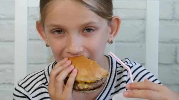 Child Eating Hamburger in Restaurant, Kid and Fast Food, Girl Drinking Juice