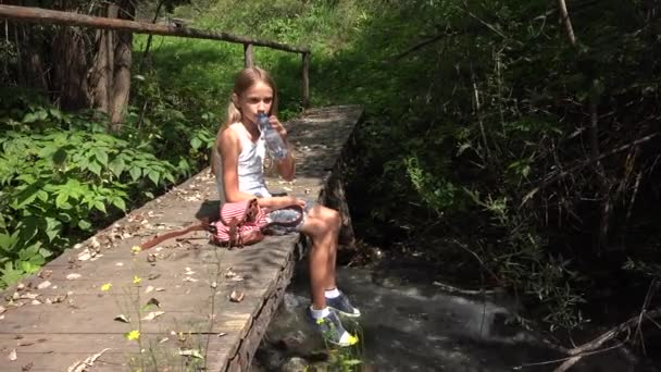 Child Playing by River Water, Kid at Camping in Mountains, Girl in Nature
