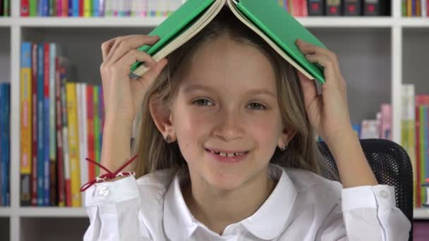 Student Kid Laughing in Library, Child Reading for School,  Expressive Girl Smiling at Camera, Children Education, Educative View