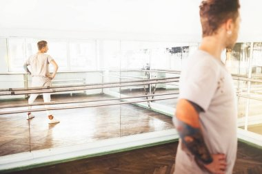 Modern tattooed art dancer teenager mirror posing portrait