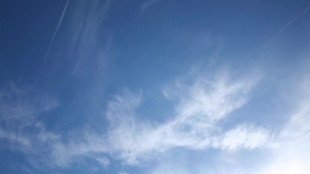 blue sky with white wispy clouds