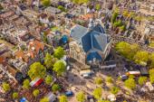 Amsterdam Aerial view over Noorderkerk and Jordaan on Koningsdag Kings day festivities. Narozeniny krále. Viděno z vrtulníku.