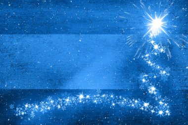 Grunge blue colored Christmas shooting star copy space illustration background.