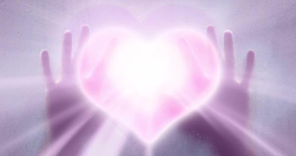 Ember kéz a kézben a művészeti homályos világos rózsaszín színű háttér szív szimbólum mozgalom.