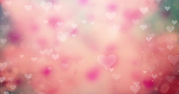 weiche weiße Herzen fliegen herum auf verschwommenem rosa rot gefärbtem Bokeh-Hintergrund.
