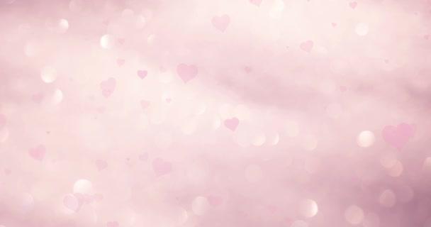 Mágikus absztrakt rózsaszín színes szívek homályos bokeh háttérben repülő.
