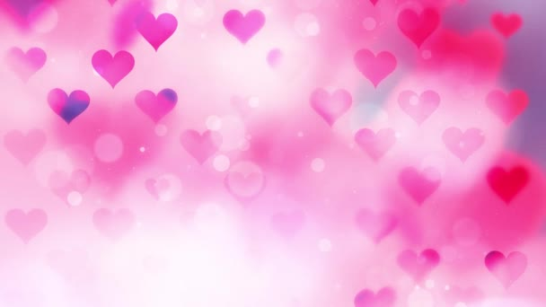 Beautiful abstract pink red colored hearts on blurry bokeh background.